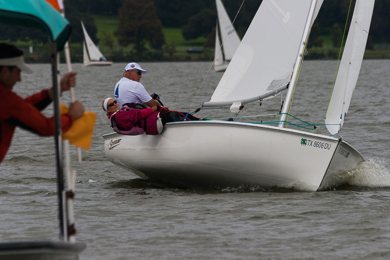 When taking photos that include the signal boat, make sure that autofocus captures the competitor.